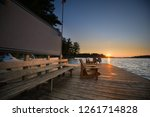 chairs on a cottage wooden dock ... | Shutterstock . vector #1261714828