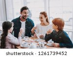 young family is resting in cafe.... | Shutterstock . vector #1261739452