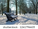 a park bench on a snowy day....