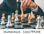 Small photo of Businessman leadership playing chess and thinking strategy plan about crash overthrow the opposite team and development analyze for successful of corporate.