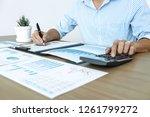 businessman accountant making... | Shutterstock . vector #1261799272
