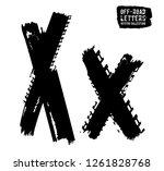 grunge tire letter x. unique... | Shutterstock .eps vector #1261828768