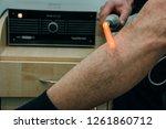 man receiving laser treatment | Shutterstock . vector #1261860712
