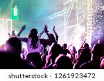cheering crowd with raised... | Shutterstock . vector #1261923472