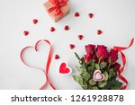 Stock photo valentines day and holidays concept close up of red roses gift red heart shaped chocolate 1261928878