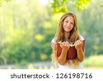 young beautiful girl reads red... | Shutterstock . vector #126198716