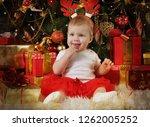 little girl  eight months of... | Shutterstock . vector #1262005252