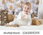 little girl  eight months of... | Shutterstock . vector #1262005255