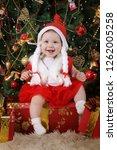 little funny girl in santa... | Shutterstock . vector #1262005258