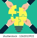 4puzzle light bulb and four... | Shutterstock .eps vector #1262013922