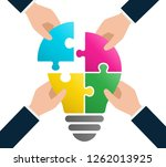 4puzzle light bulb and four... | Shutterstock .eps vector #1262013925