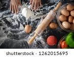 closeup of  dough  wooden... | Shutterstock . vector #1262015695