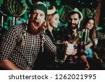 man in funny hat celebrates st... | Shutterstock . vector #1262021995