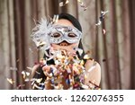 happy young woman in sequin... | Shutterstock . vector #1262076355