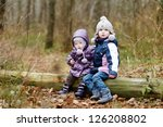 two sisters sitting on a tree... | Shutterstock . vector #126208802