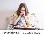 woman with a headache and flu... | Shutterstock . vector #1262174632