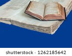 Small photo of Old book cover, vintage texture, isolated on blue background. Old Jewish Talmud in Yiddish with Bible.