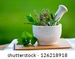 fresh herbs in the mortar  ... | Shutterstock . vector #126218918