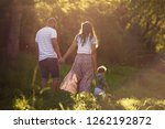 backview of family walking... | Shutterstock . vector #1262192872