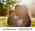 young couple with their son... | Shutterstock . vector #1262192878