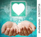 Heart Symbol on hand , medical icon - stock photo