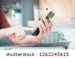close up hand take smart phone ... | Shutterstock . vector #1262245615