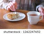 woman is eating homemade apple...   Shutterstock . vector #1262247652
