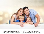 beautiful smiling family... | Shutterstock . vector #1262265442