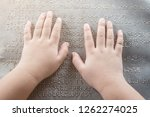 the blind kid's hand and... | Shutterstock . vector #1262274025