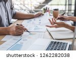 business colleagues meeting to... | Shutterstock . vector #1262282038
