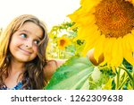 happy little girl looking at... | Shutterstock . vector #1262309638
