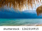 stormy sky over the beach with... | Shutterstock . vector #1262314915