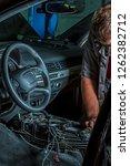 a mechanic repairs a luxury suv ... | Shutterstock . vector #1262382712