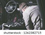 a mechanic work  repairs a... | Shutterstock . vector #1262382715