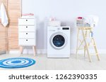 washing machine with towels in... | Shutterstock . vector #1262390335