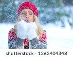 closeup shot of blonde woman... | Shutterstock . vector #1262404348