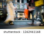 motion blurred night shoppers... | Shutterstock . vector #1262461168