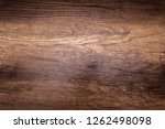 brown scratched wooden cutting... | Shutterstock . vector #1262498098