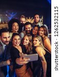 cheerful friends taking selfie...   Shutterstock . vector #1262532115