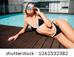 young woman sunbathing near... | Shutterstock . vector #1262532382