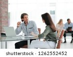 manager prepares the contract... | Shutterstock . vector #1262552452