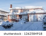 big residential house in snow... | Shutterstock . vector #1262584918