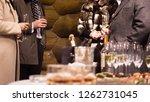 men and woman drinking near... | Shutterstock . vector #1262731045