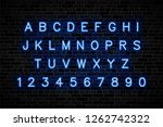 blue neon signs capital letters ...   Shutterstock .eps vector #1262742322