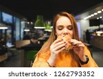 eating a burger with eyes... | Shutterstock . vector #1262793352