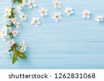 Spring Flowers On Blue Wooden...