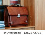 office with leather briefcase... | Shutterstock . vector #1262872738