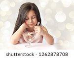 happy child girl eating ice...   Shutterstock . vector #1262878708
