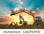 Four Excavators Work On...