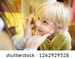face painting for cute little... | Shutterstock . vector #1262929528